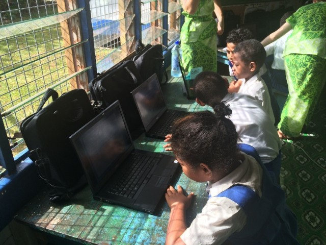 Year 5 students practicing their presentations