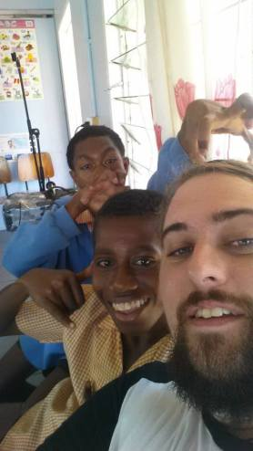 Matthew and some students posing for a selfie