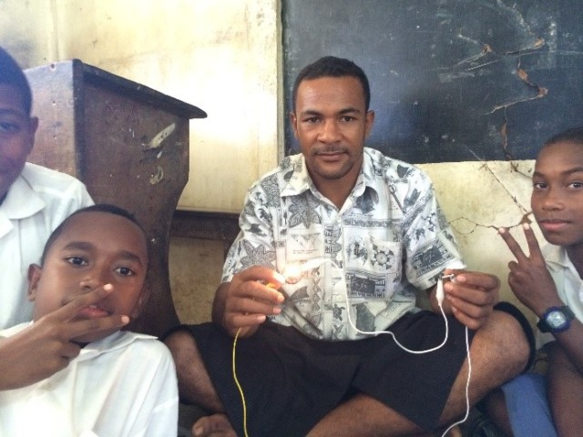 Teacher and students using the new electronics kit.