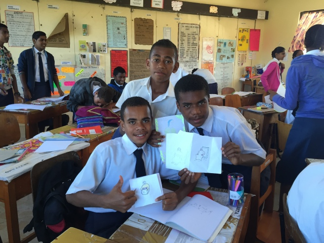 Some enthusiastic students showing off their work