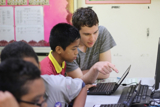 Anthony making a point to a student in Class 6 (Photo: Ibnu Isa).