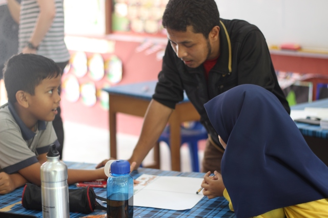 Fatin helping one of the groups in Class